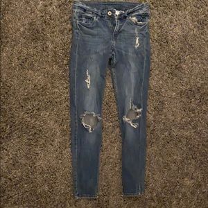 Ripped dark wash jeans